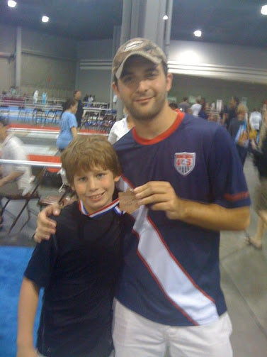 Coach Lehfeldt with a student at summer national championships